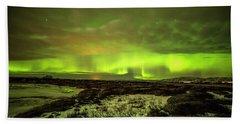 Aurora Borealis Over A Frozen Lake Beach Towel