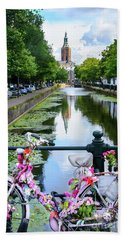 Beach Towel featuring the digital art Canal And Decorated Bike In The Hague by RicardMN Photography