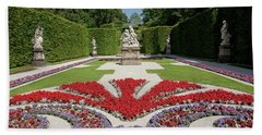 Flowerbeds And Sculptures In Eastern Parterre Beach Towel