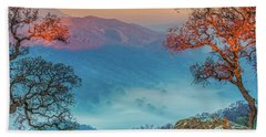 Fog In The Valley Beach Towel by Marc Crumpler