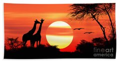 Giraffes At Sunset Beach Towel