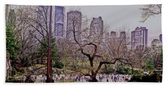 Ice Skaters On Wollman Rink Beach Towel by Sandy Moulder