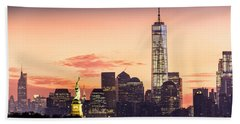 Lower Manhattan And The Statue Of Liberty At Sunrise Beach Towel