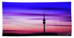Beach Towel featuring the photograph Munich - Olympiaturm At Sunset by Hannes Cmarits