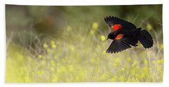 Red Winged Blackbird In Flight Beach Sheet