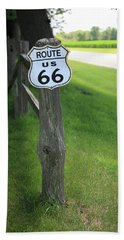 Beach Towel featuring the photograph Route 66 Shield And Fence Post by Frank Romeo