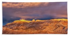Beach Towel featuring the photograph Sandia Crest Stormy Sunset by Alan Vance Ley