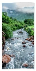 Beach Towel featuring the photograph Stream by Charuhas Images