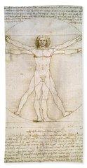 The Proportions Of The Human Figure Beach Towel by Leonardo da Vinci