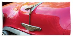 Beach Towel featuring the photograph Vintage Chevy Hood Ornament Havana Cuba by Charles Harden
