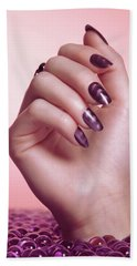 Woman Hand With Purple Nail Polish Beach Towel