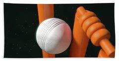 Cricket Ball Hitting Wickets Beach Towel by Allan Swart