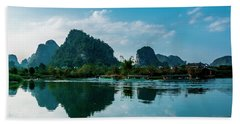 The Karst Mountains And River Scenery Beach Towel