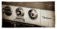 Beach Towel featuring the photograph 1955 Ford Fairlane Dashboard Emblem -0444s by Jill Reger