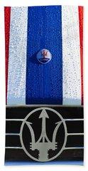 Beach Towel featuring the photograph 1956 Maserati 350 S Hood Ornament Emblem 3 by Jill Reger