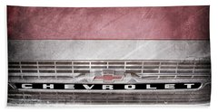 Beach Towel featuring the photograph 1961 Chevrolet Corvair Pickup Truck Grille Emblem -0130ac by Jill Reger