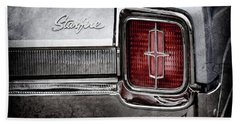 Beach Towel featuring the photograph 1965 Oldsmobile Starfire Taillight Emblem -0212ac by Jill Reger
