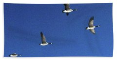4 Geese In Flight Beach Sheet