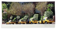 4 Taxis In The City Beach Towel