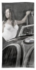 Beach Towel featuring the photograph The Girl On The Background Of Vintage Car. by Andrey  Godyaykin