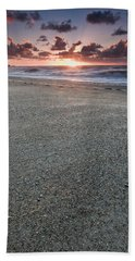 A Beach During Sunset With Glowing Sky Beach Towel