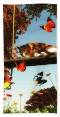 A Cat Looks At The Butterflies Beach Towel