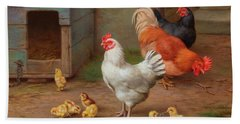 A Cockerel, Hens And Chicks By A Pail Beach Towel
