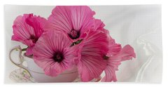A Cup Of Pink Lavatera Flowers Beach Towel by Sandra Foster