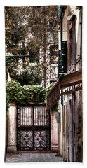 Beach Towel featuring the photograph A Doorway In Venice With Oil Effect by Tom Prendergast