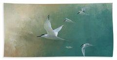 A Flight Of Terns Beach Towel