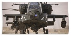 A Group Of Ah-64d Apache Helicopters Beach Towel