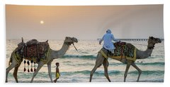 A Little Boy Stares In Amazement At A Camel Riding On Marina Beach In Dubai, United Arab Emirates Beach Towel