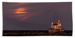 A Moonsetting Sunrise Beach Towel by Everet Regal