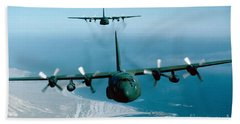 A Pair Of C-130 Hercules In Flight Beach Towel