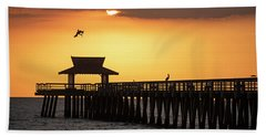 A Pelican Dive-bomb At The Naples Pier Naples Fl Beach Towel