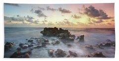 A Rocky Sunrise. Beach Towel