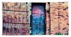 A Rusty Loading Dock Door Beach Towel by Diana Mary Sharpton