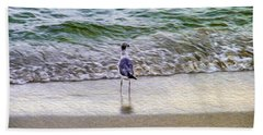 A Seagull Looking Out To Sea Beach Towel