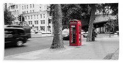 A Single Red Telephone Box On The Street Bw Beach Sheet