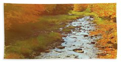 A Small Stream Bright Fall Color. Beach Towel