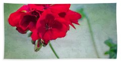 Beach Towel featuring the photograph A Splash Of Red by Betty LaRue
