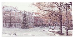 Beach Towel featuring the photograph A Street In Warsaw, Poland On A Snowy Day by Juli Scalzi