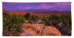 A Sunset Over Arches Beach Towel