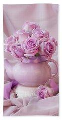 A Tea Pot Of Lavender Pink Roses  Beach Towel