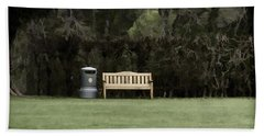 A Trash Can And Wooden Benches In A Small Grassy Area Beach Towel