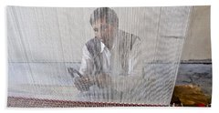 A Weaver Weaves A Carpet. Beach Towel
