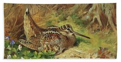A Woodcock And Chicks Beach Towel by Archibald Thorburn