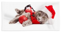 Adorable Christmas Kitten Over White Beach Towel
