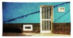 Beach Towel featuring the photograph Alcala Blue Wall White Door by Anne Kotan