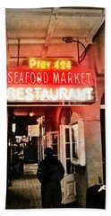 Beach Towel featuring the photograph Along Bourbon Street - New Orleans by Glenn McCarthy Art and Photography